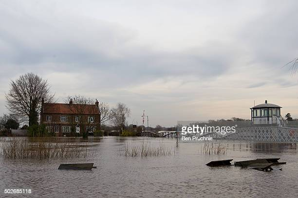 Picnic tables from The Ferry Inn float in the River Ouse on December 28 2015 in Cawood England Heavy rain over the Christmas period has caused severe...