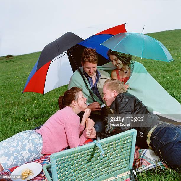 picnic with friends - warme kleidung stock-fotos und bilder