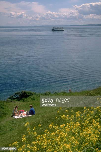 Picnickers enjoy a quiet view of the Puget Sound from Keystone Point on Whidbey Island in Washington | Location Keystone Point Fort Casey State Park...