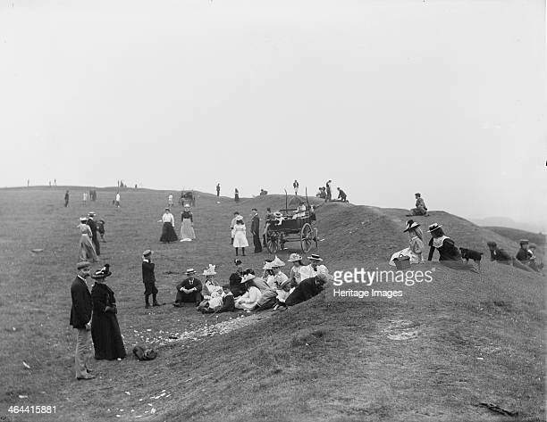 Picnickers enjoying a bank holiday lunch, Uffington Castle, Oxfordshire, 1900. Picnickers enjoying a bank holiday lunch along the hillfort ramparts....