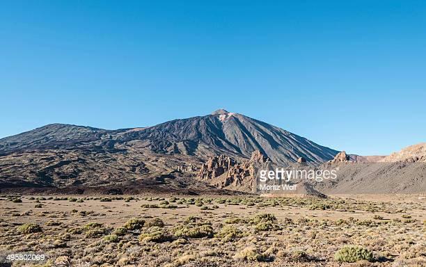 Pico del Teide or Mount Teide with the rock formation Roques de Garcia, Roque Cinchado, volcanic landscape, Llano de Uruanca plateau, Parque Nacional de las Canadas del Teide, Teide National Park, UNESCO World Natural Heritage Site, Tenerife, Canary