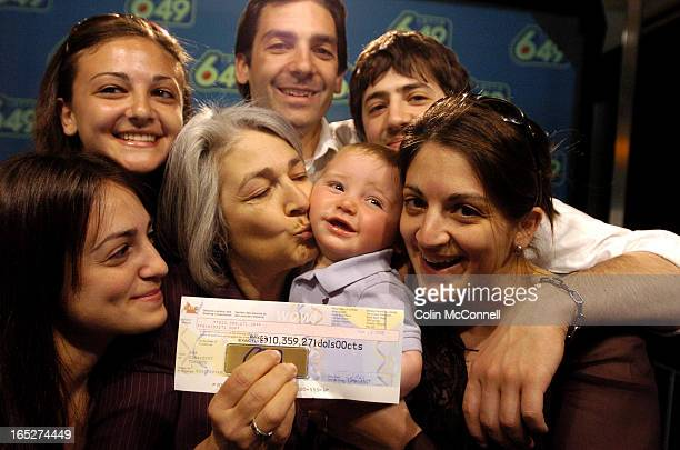 Pics of 10 million dollar lottary winner maria gallo of toronto with her five children and her grandson.she went out to buy a carton of milk and the...