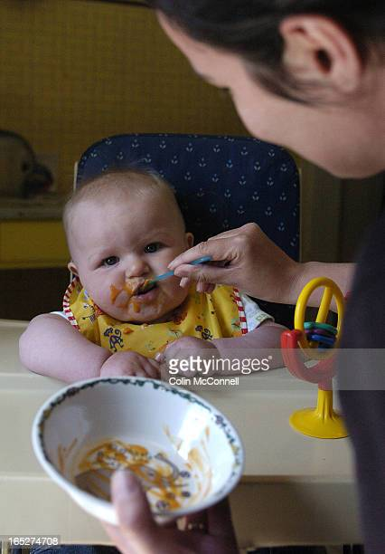 Pics of baby duncan and his mom erin hawkins getting his solid food training and a messy one it is.