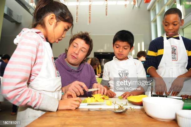 pics of jamie oliver at the artscape food centre on christie street where he talks to and helps around 20 kids make lunch and answers their questions...