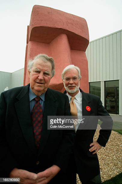 pics of sir edmund hillary on the left and alex tilley on the right in front of the tilley endurables store in don mills to go with story on how we...