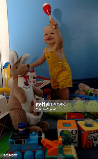 Pics of soon to be one year old baby duncan macinnes surrounded by some of his toys to go with story written by his mom erin hawkins about money they...