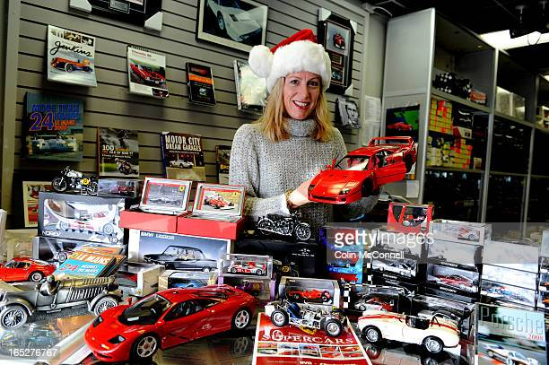 pics of trish stafferton to go with norris mc donalds annual christmas gift column in wheelsshots of her with a selection of bookscars dvds etc in...