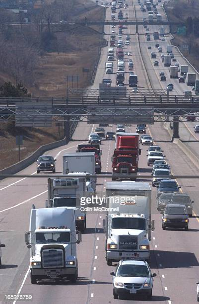 03/22/04 pics of truck traffic on hwy 401 east and westbound taken from atop the hwy at mavis rdto go with story on peel having lots of trucks on...