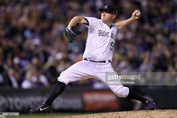 Picther Jake McGee of the Colorado Rockies throws in the seventh inning against the Los Angeles Dodgers at Coors Field on September 30 2017 in Denver...