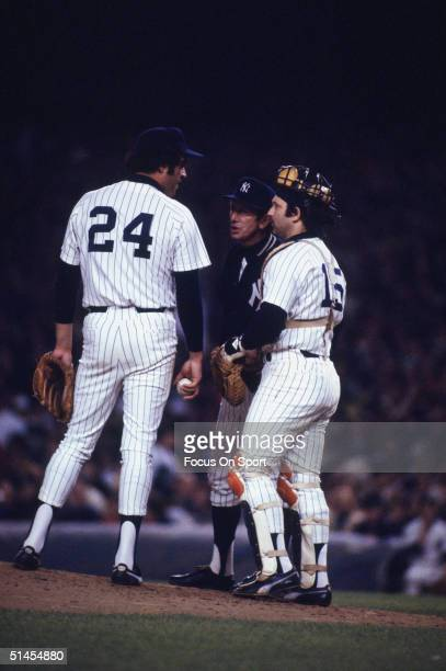 Picther Mike Torrez on the mound with manager Billy Martin and catcher Thurman Munson during the World Series at Yankee Stadium on October 1977 in...