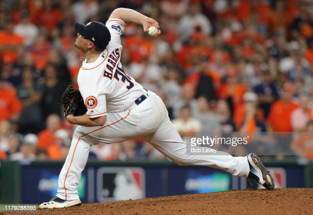 Picther Will Harris of the Houston Astros delivers in the ninth inning of Game 2 of the ALDS against the Tampa Bay Rays at Minute Maid Park on...