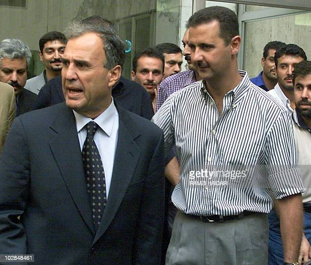 Pictue taken 06 October 1999 shows Syrian President Hafez alAssad's son Bashar and Ghazi Kanaan head of Syrian intelligence forces in Lebanon heading...