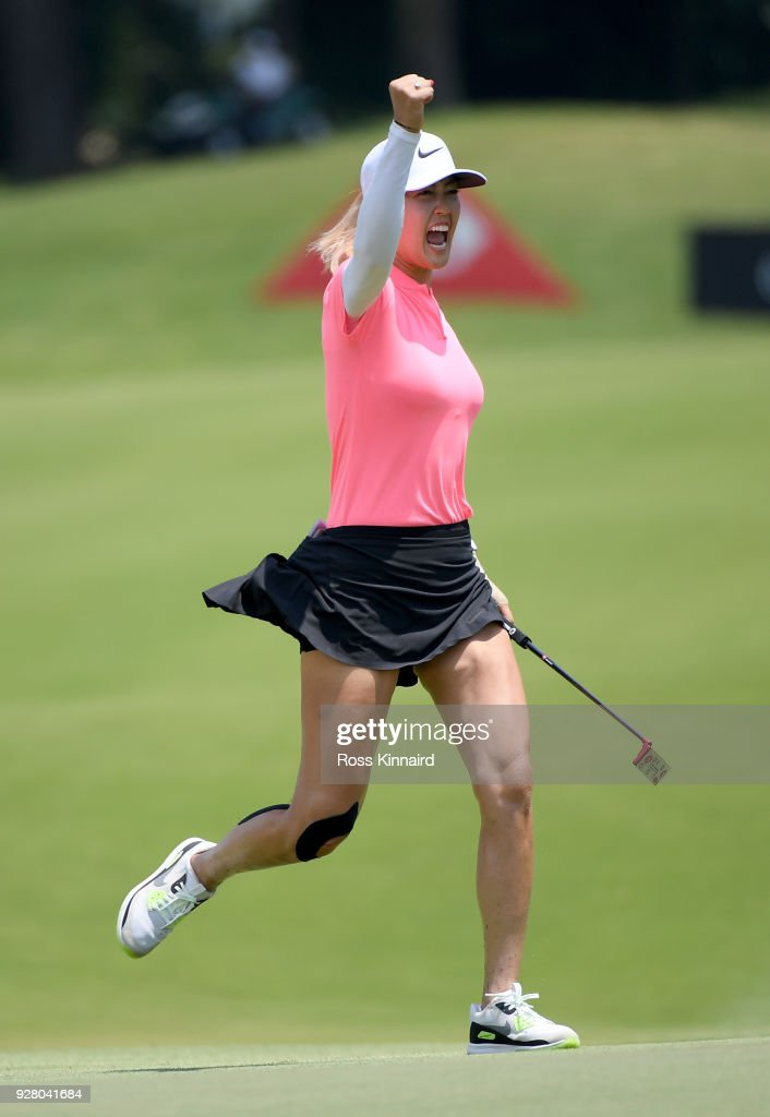 Picture 8 of 9 in a sequence showing the winning putt and celebration of Michelle Wie of the United States on the 18th green during the final round of the HSBC Women's World Championship at Sentosa Golf Club on March 4, 2018 in Singapore.