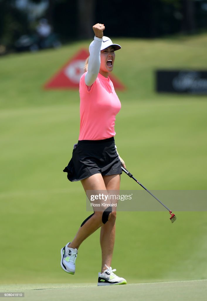 Picture 9 of 9 in a sequence showing the winning putt and celebration of Michelle Wie of the United States on the 18th green during the final round of the HSBC Women's World Championship at Sentosa Golf Club on March 4, 2018 in Singapore.