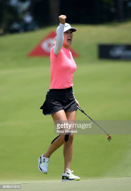 Picture 9 of 9 in a sequence showing the winning putt and celebration of Michelle Wie of the United States on the 18th green during the final round...