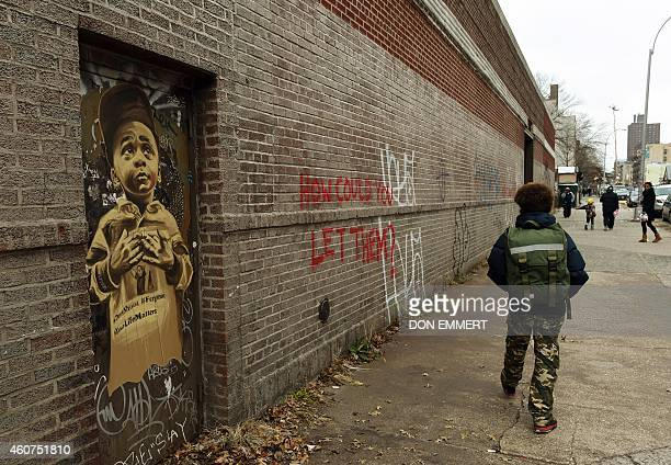 A picture and graffiti on a door and wall near the intersection of Tompkins Ave and Myrtle Ave December 21 2014 in New York near the site where two...