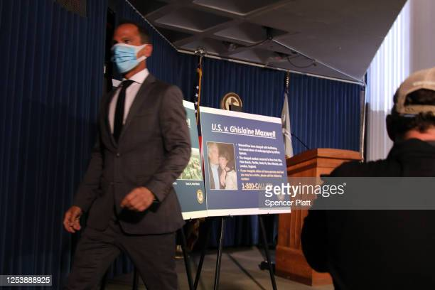 Picture boards are placed on a stand at a press conference to announce the arrest of Ghislaine Maxwell the longtime girlfriend and accused accomplice...