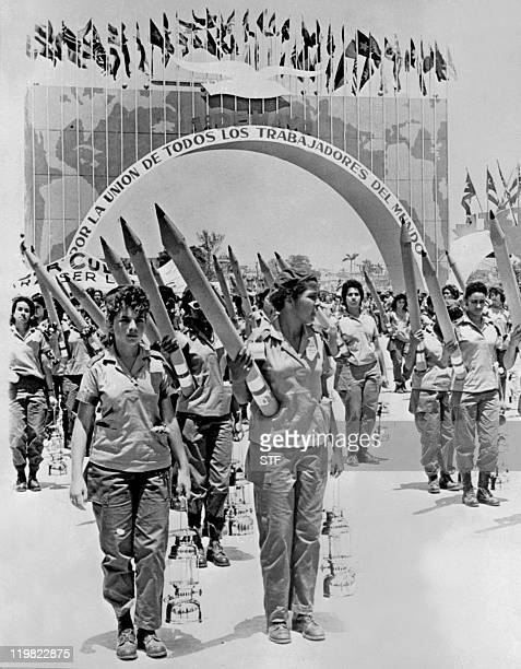 Picture dated 01 May 1961 of young women working for a literacy campaign parading with big pencils in the streets of La Havana during the Cuban...