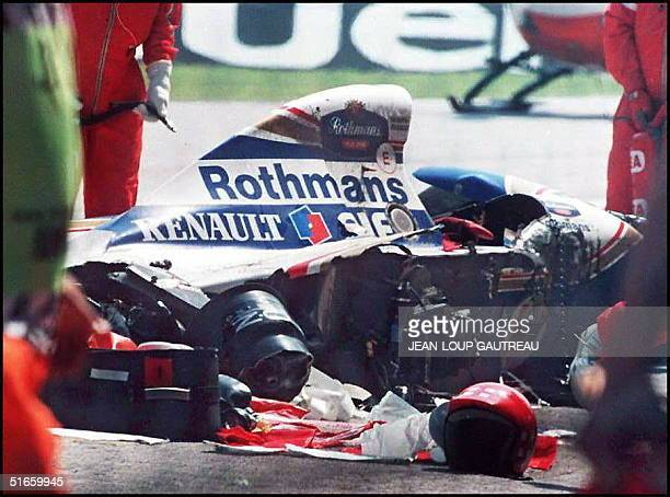 Picture dated 01 May 1994 of Brazilian F1 driver Ayrton Senna's car after its crash at the Imola circuit His team owner Frank Williams and senior...