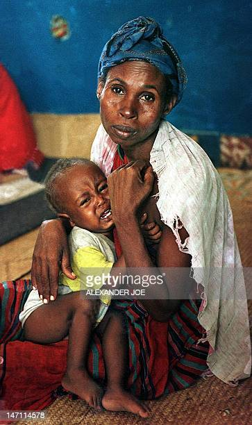 Picture dated 08 June 1997 showing a Somali mother and her malnourished child at the Towfiq feeding center in south Mogadishu The United Nations...