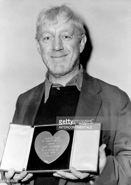 Picture dated 09 April 1958 of British actor Alec Guinness posing for photographer at the Savoy hotel in London after being awarded by the...