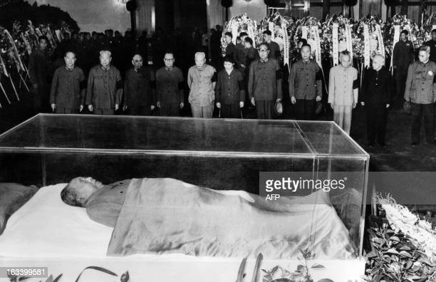 Picture dated 13 September 1976 in Beijing and released by the Chinese official news agency Party and state leaders standing vigil before the remains...