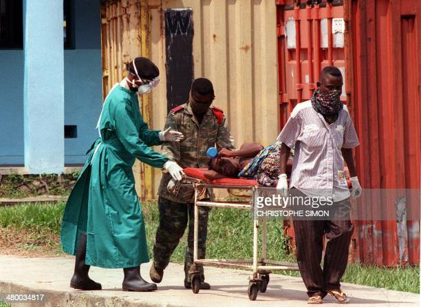 A picture dated 14 May 1995 shows a patient affected by the deadly Ebola virus carried on a stretcher at the Kikwit hospital 530km southeast of the...