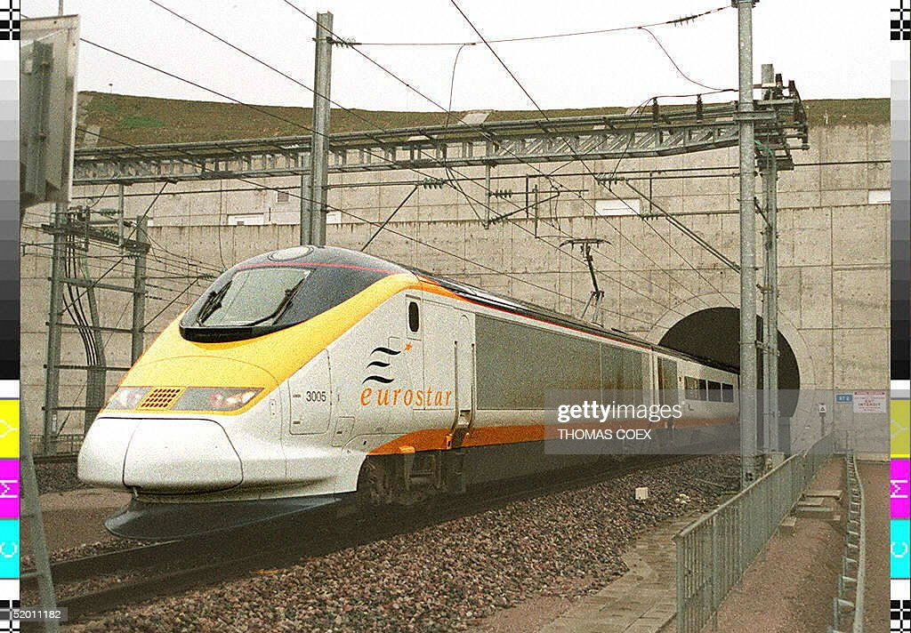 Picture dated 14 November 1994 shows the first Eurostar commercial train leaving the Chunnel en route to Paris. Five persons were injured, one seriously, when fire broke out late 18 November on a freight train in the Channel Tunnel between France and England. The five were given first aid in the service tunnel. 28 other passengers were evacuated to a car shuttle.