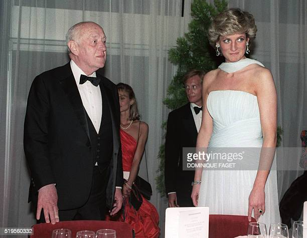 Picture dated 15 May 1987 of British actor Alec Guinness and Princess Diana at a gala dinner at the 40th Cannes film festival on the French riviera...