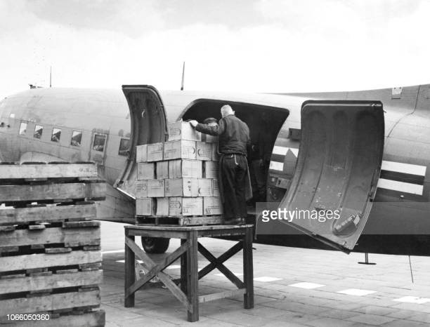 Picture dated 16 March 1948 at Berlin Tempelhof airport showing the unloading of one of the first air cargo used by the US army after the railway...