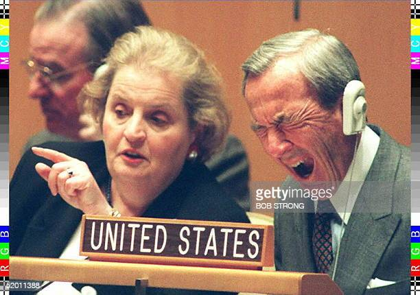 Picture dated 17 April 95 shows US Secretary of State Warren Christopher yawning while US Ambassador Madeleine Albright talks during opening...