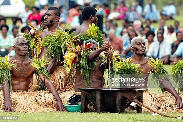 Picture dated 17 July 2002 shows Viti Levu chiefs including a pair of identical twins preparing yaqona root for kava during the traditional welcome...