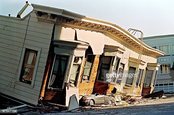 Picture dated 18 October 1989 in San Francisco of a collapsed house that crushed a car parked on the street in the Marina District during a quake...