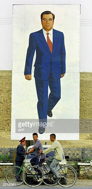 Picture dated 18 October 2001 shows a huge mural of Tajikistan's President Emomali Rakhmonov over a police checkpoint on a rural road in Tajikistan...