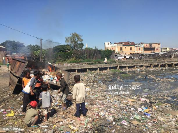 A picture dated 19 April 2016 shows children playing in piles of rubbish in the slum of Antananarivo Madagascar where the nutrition centre by the aid...