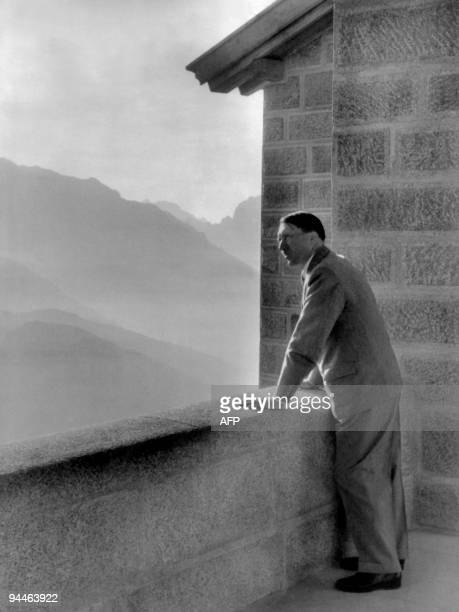 A picture dated 1938 shows German nazi Chancellor Adolf Hitler looking at the Obersalzberg Mountains from a balcony of his Berghof residence near...