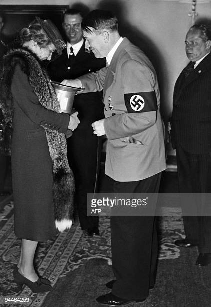 A picture dated 1939 shows German nazi Chancellor and dictator Adolf Hitler with an unidentified woman AFP PHOTO / FRANCE PRESSE VOIR