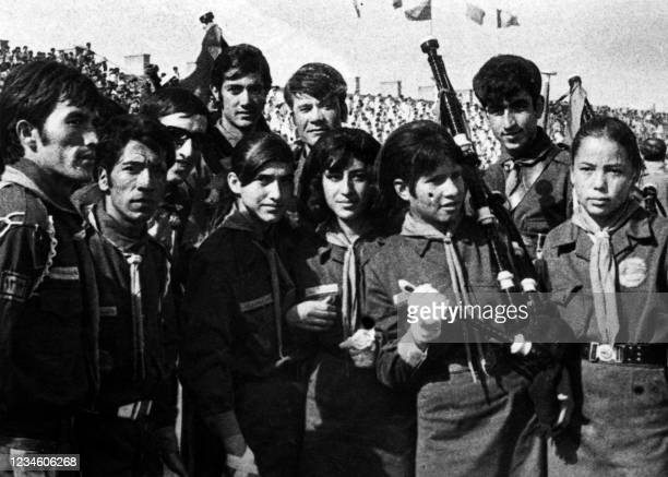Picture dated 1970 showing young scout women and men parading together in Kabul during a youth gathering.