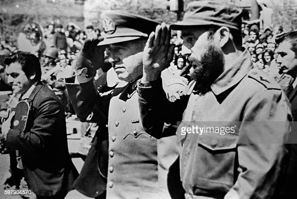 Picture dated 1971 showing General Augusto Pinochet then Chile's army chief saluting with Cuban leader Fidel Castro during Castro's visit to Chile...