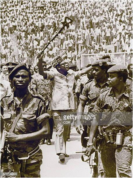 Picture dated 20 April 1977 of former Zairean president Mobutu Sese Seko brandishing his sculpted stick as he acknowledges a cheering crowd at a...