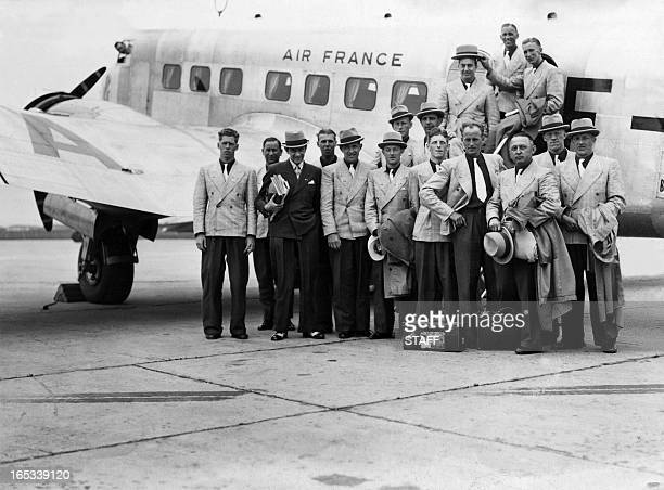Picture dated 20 July 1938 at Paris' Bourget Airport shows nonidentified Swedish football players posing in front of an Air France propeller plane...