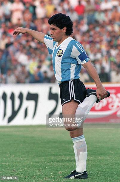 Picture dated 22 May 1990 showing Argentinian soccer player Diego Maradona wearing the color of his native country Argentinian football legend Diego...