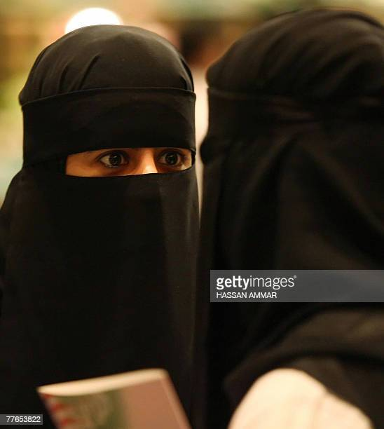 A picture dated 23 October 2007 shows a Saudi student speaking to her friend as they attend a medical gathering at King Fahd Medical City in Riyadh...