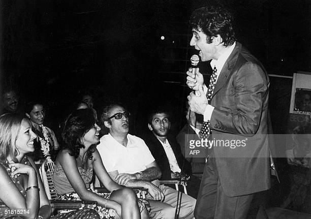 picture dated 24 June 1974 shows French singersongwriter Gilbert Becaud performing during the summer Byblos festival in the northern Lebanese ancient...