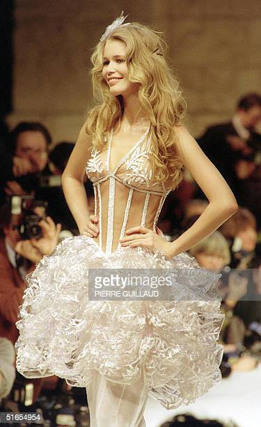 Picture dated 26 January 1993 shows top model Claudia Schiffer as she wears a transparent guOpiFre and skirt of crinkled plastic styled by Karl...