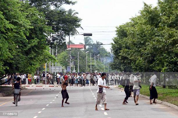 Picture dated 27 September 2007 shows Myanmar soldiers try to chase protestors in downtown Yangon. China's Premier Wen Jiabao on 29 September 2007...