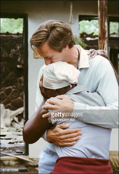 Picture dated 28 November 1987 of doctor Kevin Martin consoling Esnath Dube the witness to the murder of the 16 Christian Missionaries and a sixweek...