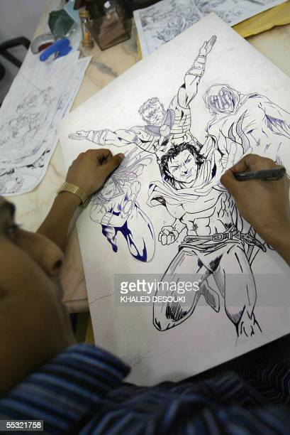 A picture dated 31 August 2005 shows an Egyptian artist drawing cartoons for Arab comic book series AK COMICS which presents genuine league of...