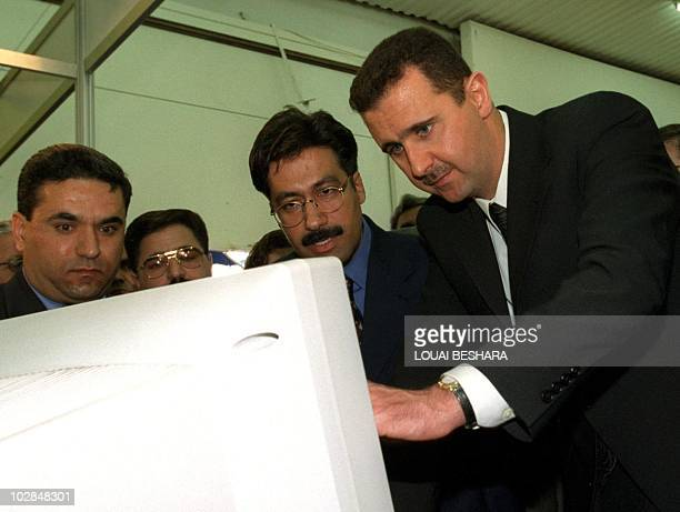Picture dated April 1999 shows Bashar alAssad looking at a computer monitor at the Damascus International Exhibition Bashar is poised to succeed his...