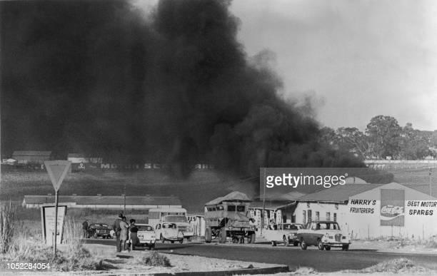 Picture dated August 1976 in Soweto of buildings burning during a black students protest against having to use Afrikaans language at school After...